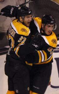 Patrice Bergeron (left) celebrates with Brad Marchand after scoring in the second period.