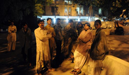 Pakistani residents stood outside a building yesterday in Islamabad after an earthquake centered in the Hindu Kush mountains shook a wide area of eastern Afghanistan and Pakistan.
