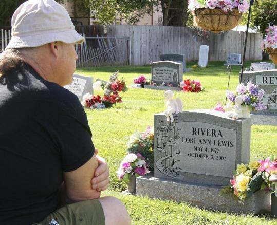 "Marion Lewis, shown at the grave of Lori Ann Lewis-Rivera, will be interviewed on ""Inside Edition'' about the execution."