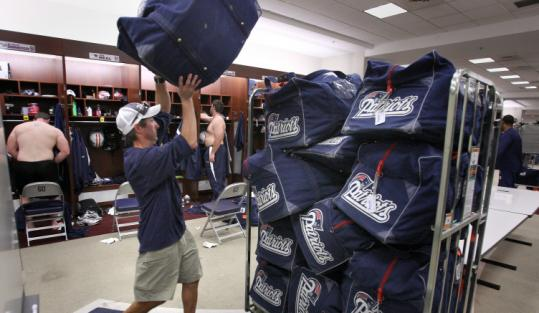Patriots assistant equipment manager John Hillebrand loads players' bags for the trip to London to play the Buccaneers.