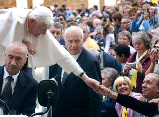 Camillo Cibin, center, also served as a bodyguard for Pope Benedict XVI. He retired in 2006 after a 58-year career.