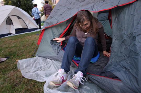 Northeastern University student Alyssa Pandolfi crawled out of her tent on Boston Common yesterday.