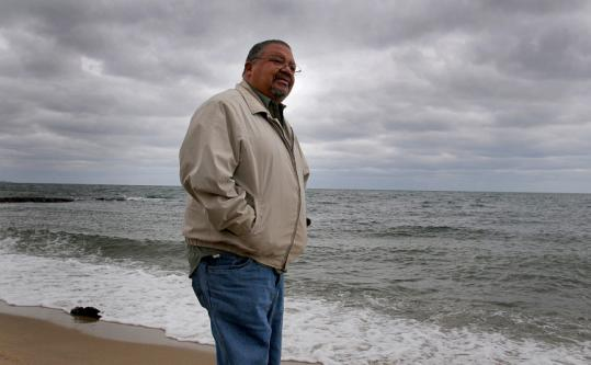 Wampanoag tribal officer George Green stood at Popponesset Beach in Mashpee where wind turbines will be placed.