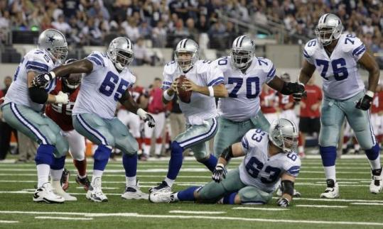 A more improvisational Tony Romo put his legs to use while keeping his arm sharp, throwing for 311 yards and three TDs.