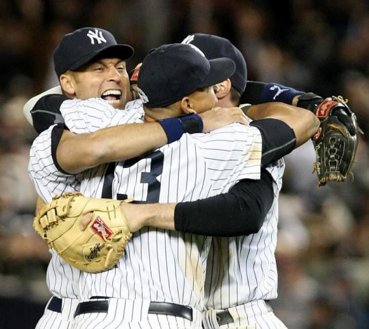 Yankee stars (from left) Derek Jeter, Alex Rodriguez, and Mark Teixeira get together to celebrate after the final out.