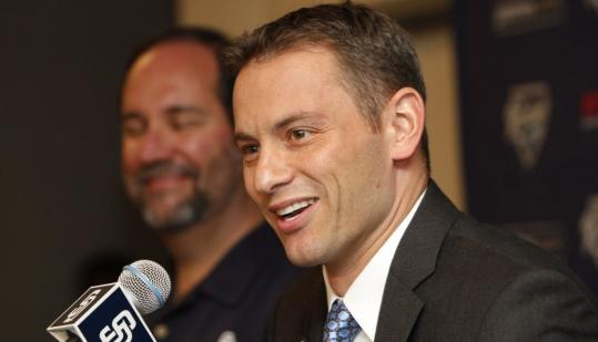 Thanks to a long-term contract from owner Jeff Moorad (left) and a well-stocked farm system, Jed Hoyer had plenty to smile about when he was introduced to the media as the Padres' GM.