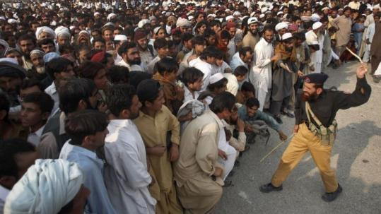 A policeman threatened to strike a man yesterday for cutting in line at a food distribution point in South Waziristan.