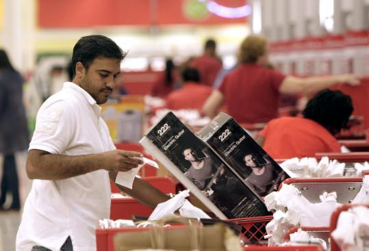 Alvaro Medina, of Creedmoor, N.C., checked out at Super Target in Durham, N.C., yesterday. Consumer spending accounts for about 70 percent of US economic activity.