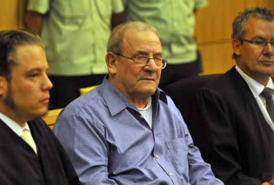 Confessed killer Heinrich Boere, 88, was flanked by lawyers Gorden Christiansen (left) and Matthias Rahmlow during the start of yesterday's trial.