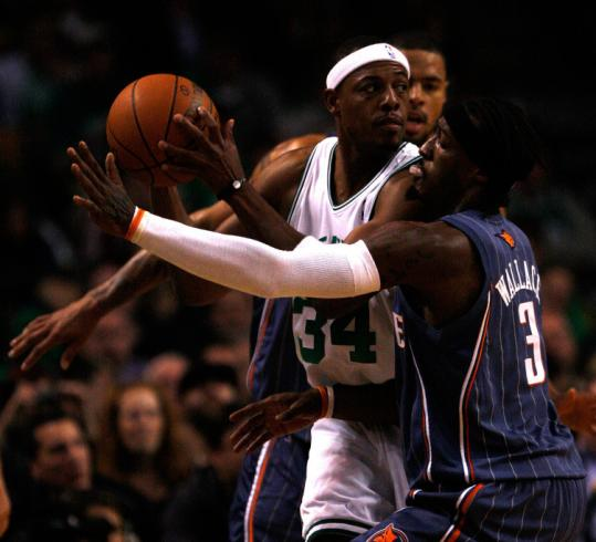In last night's home opener at the Garden, Paul Pierce drew a double-team from a pair of Bobcats in first-half action.