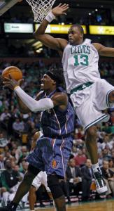 Shelden Williams takes to high road to prevent a layup by Gerald Wallace.