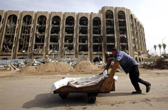 Iraqis have questioned how bombers got near the Ministry of Justice on Sunday without being discovered at a checkpoint.