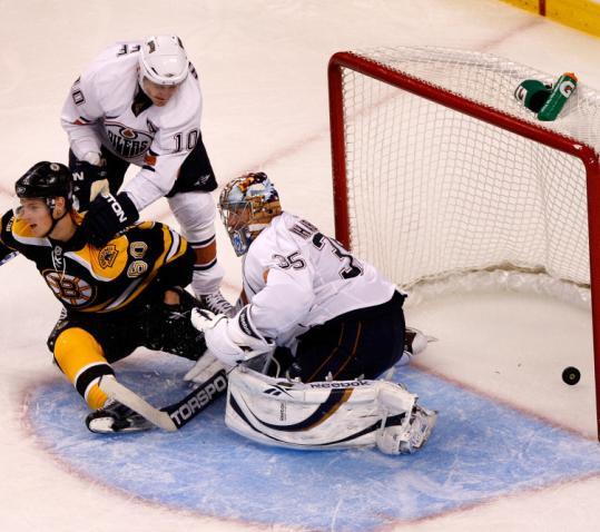 Vladimir Sobotka scores the Bruins' second goal of the game in the third period against Oilers goalie Nikolai Khabibulin.