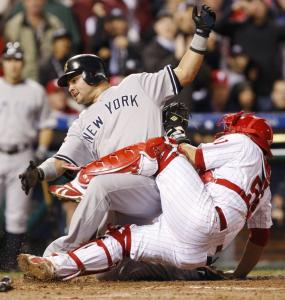 Nick Swisher beat the throw to Carlos Ruiz to score on Andy Pettitte's single in the fifth.