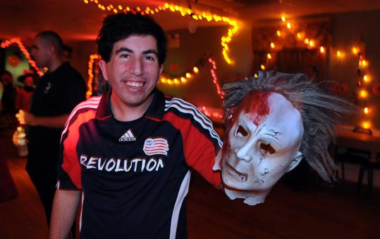 Steven Doherty, 26, of Scituate displayed his mask during a Halloween party for children and adults with special needs last night at the Knights of Columbus Lodge in Pembroke. About 150 people attended the event, organized by Kevin McKenna of Hanson.