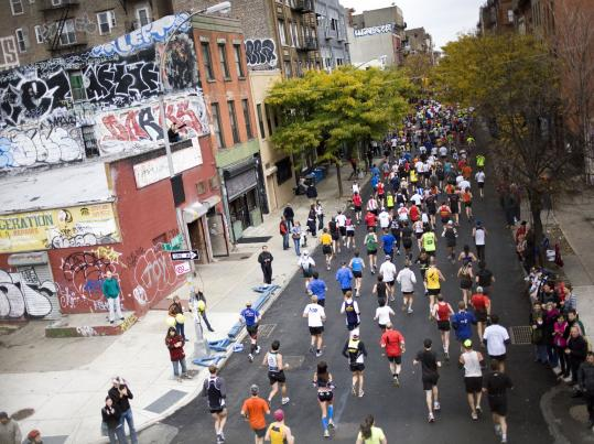Runners pass through the Williamsburg section of Brooklyn during the 40th running of New York City Marathon.
