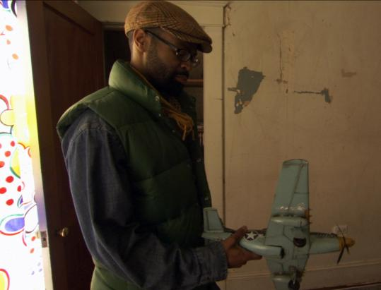 "Baltimore schoolteacher Denzel Mitchell in his foreclosed home in ""American Casino.''"