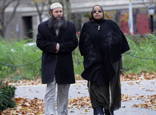 Imam Ahmad Afzali, accused of lying to the FBI, arrived at Brooklyn federal court with his wife, Fatima, yesterday.