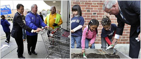 Mayor Thomas M. Menino (right) aided Thomas A. Edison School pupils (from left) Jonathan Wilson, Michelle Dang, Nardos Abraham, and Crystal Soto with their planting yesterday, w
