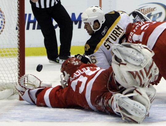 Boston's Marco Sturm hit the deck but couldn't hit the net as Chris Osgood turned his bid aside.