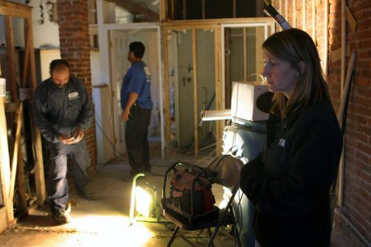 Yesterday, at her Claremont Avenue home, Lynne Rizzo checked out the damage caused by a water main break last week.