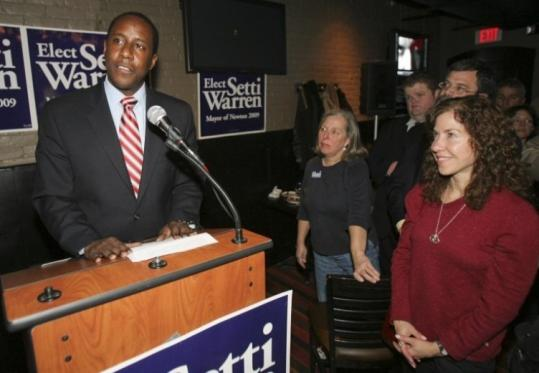 Mayor Setti Warren of Newton, who won office Tuesday, served in Iraq as an intelligence officer with the Navy Reserve.