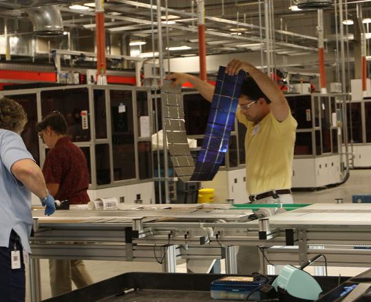 Evergreen Solar, which manufactures at its Devens plant the wafers and cells used in solar panels, will move the final assembly of those panels to a new plant in China.