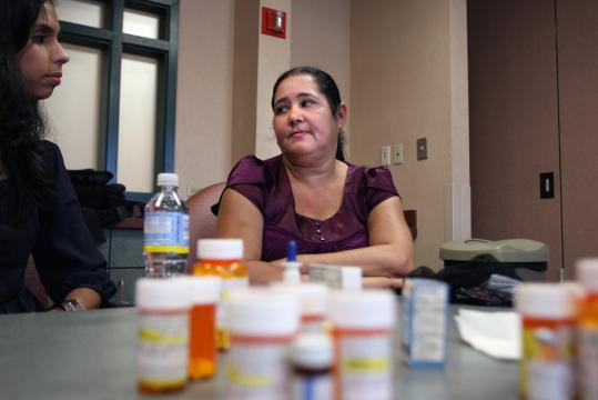 Amparo Villa, 51, of Lawrence takes 16 medications and now must travel to Methuen for doctor visits.