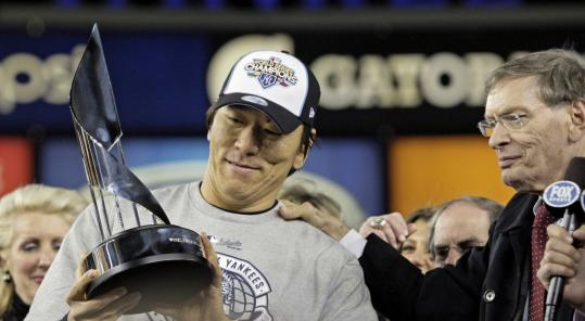 Hideki Matsui, who had six RBIs in Game 6, admired the World Series MVP trophy he was given by commissioner Bud Selig.