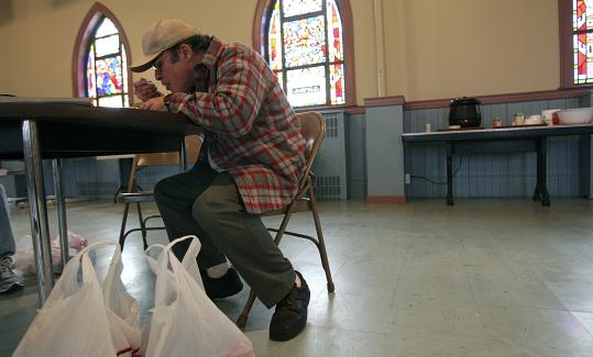 At the Veterans Northeast Outreach Center in Haverhill, Andre Gaumont pauses for some hot soup while checking out the services available to him.