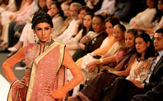 A model displayed the work of Pakistani designer Faiza Samee in Karachi yesterday, the last day of Pakistan Fashion Week.