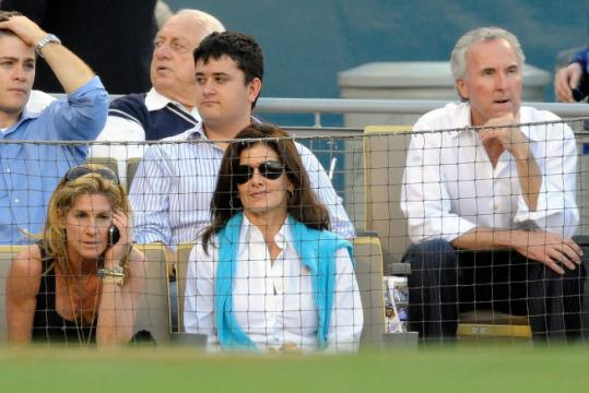 Jamie McCourt (far left) and Frank McCourt (far right) at a Dodgers playoff game against the Phillies.