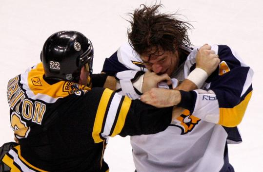 Shawn Thornton (left) takes on former Bruins teammate Steve Montador in the first period of a chippy contest.