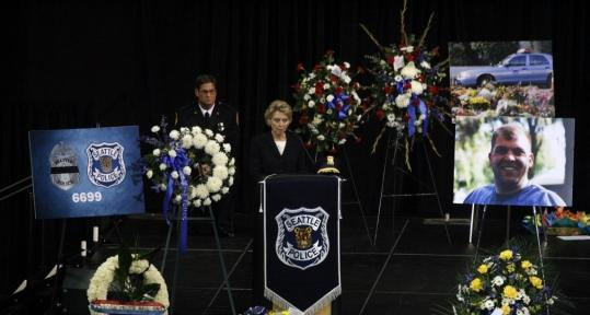 Governor Christine Gregoire spoke at a memorial service Friday for Officer Timothy Brenton in Seattle. The man suspected of shooting Brenton was shot by police the same day as the service.