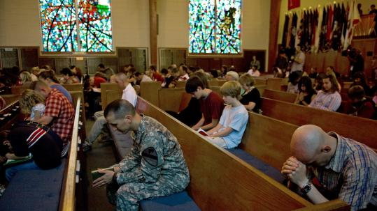 During services at Fort Hood's 1st Cavalry Memorial Chapel, attendees were asked to pray for the slain and the alleged gunman.