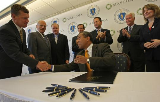 Governor Deval Patrick shook hands with former MASCOMA company president Colin Smith after he signed the Clean Energy Biofuels Act last year at the company's former Boston headquarters.