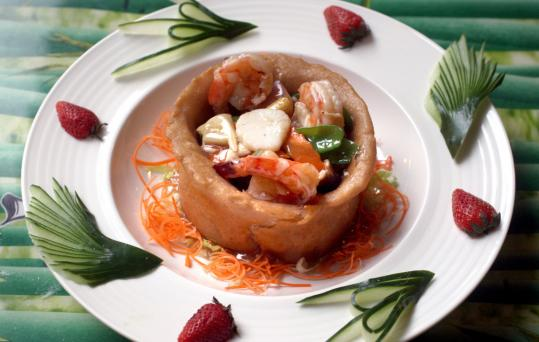 Sarang burong is shrimp, chicken, and vegetables served in a basket made from fried taro root.