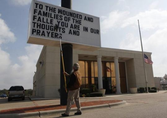 A man prepared a message to the wounded and families of the victims of the Fort Hood shootings yesterday in Killeen, Texas.