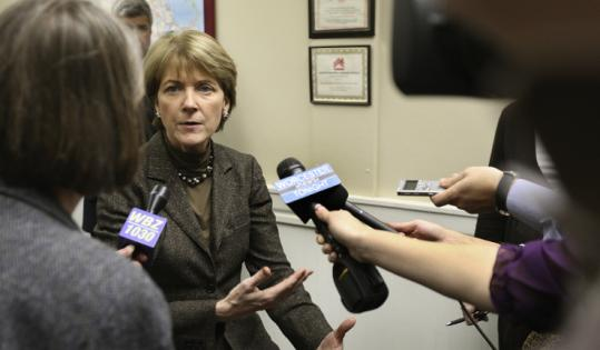 Attorney General Martha Coakley spoke to reporters during a tour of a shelter for homeless veterans in Worcester yesterday.