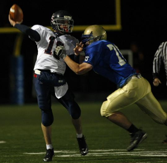 Lincoln-Sudbury Regional&#8217;s Matthew Cahill makes a pass in his team&#8217;s 7-0 win over Acton-Boxborough Regional, a highlight in a tough season for the Warriors. The loss denied Colonials coach Bill Maver his 200th career win.