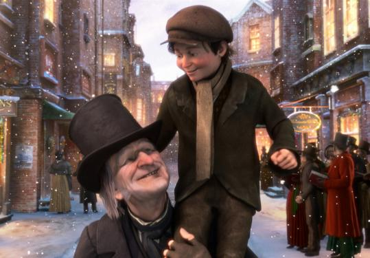 "Scrooge (voiced by Jim Carrey) lifts Tiny Tim (voiced by Gary Oldman) in ""A Christmas Carol.''"