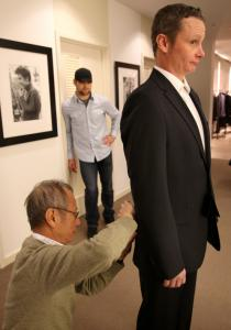 Tailor Kwok Hung Ng fitted Robert Hornbrook as Bruins player Mark Stuart stood by at Saks.