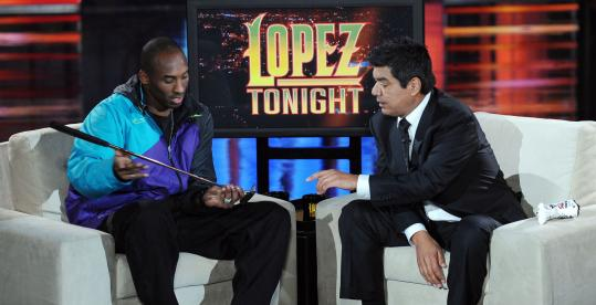 George Lopez chats with NBA star Kobe Bryant during the first week of Lopez's new talk show on TBS.