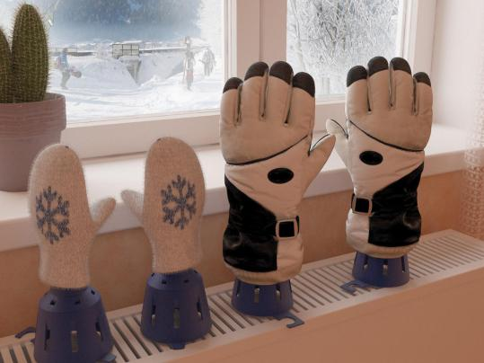 The Glove Dryer sits atop a vent or radiator and allows the air to flow into the wet mitts.