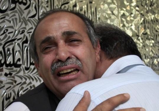 A man cried yesterday after the slaying of a Pakistani working at the Iranian Consulate in Peshawar, Pakistan.