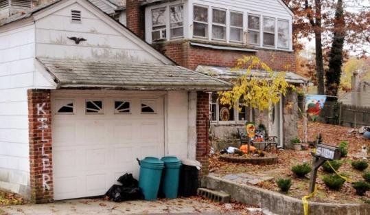 """Killer'' was spray-painted on the brickwork of Sharon McDonough's garage at her Selden, N.Y., home."