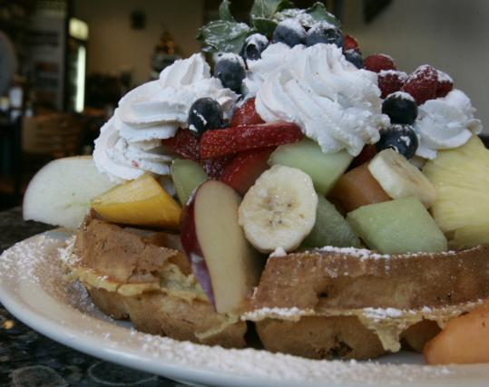 Suzanne Kreiter/Globe Staff/file A Belgian waffle with fruit exemplifies the generous portion size.