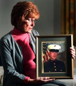 Christine Devlin displayed a photo of her son Michael, who was killed in a 1983 terrorist bombing in Beirut. Below, US Marines pulled survivors from the rubble.