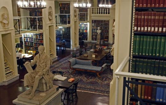 The fifth-floor reading room at the Boston Athenaeum offers ideal conditions to curl up with a book.