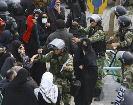 Police controlled the crowd during an antigovernment protest near state-sanctioned rallies held in Tehran on Nov. 4 to mark the 30th anniversary of the US Embassy takeover in Iran.